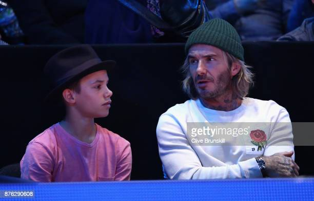 David Beckham and his son Romeo Beckham watch on during the singles final between Grigor Dimitrov of Bulgaria David Goffin of Belgium during day...