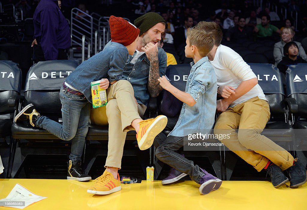 David Beckham and his sons Cruz Beckham (L) Romeo Beckham and Brooklyn Beckham (R) attend the Los Angeles Lakers and Phoenix Suns NBA basketball game at Staples Center on November 16, 2012 in Los Angeles, California.