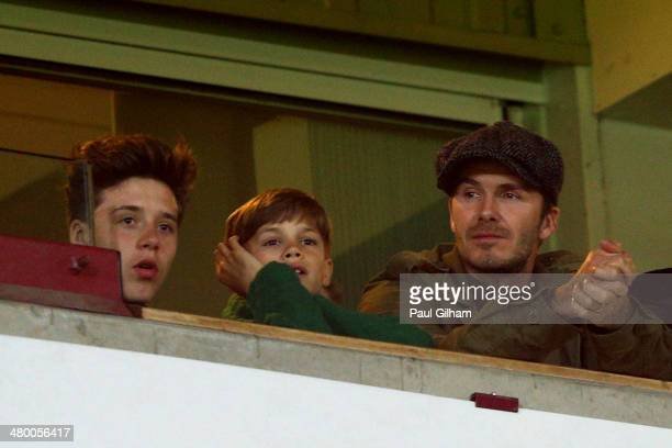 David Beckham and his sons Romeo Beckham and Brooklyn Beckham watch the action during the Barclays Premier League match between West Ham United and...