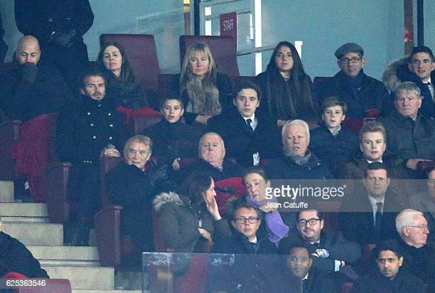 David Beckham and his three sons Romeo Beckham Brooklyn Beckham Cruz Beckham attend the UEFA Champions League match between Arsenal FC and Paris...