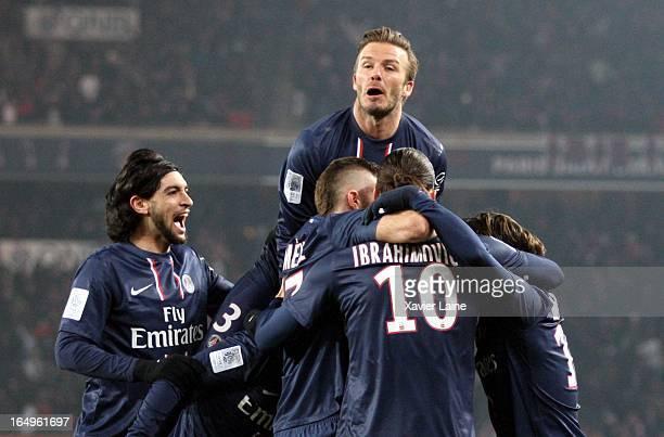David Beckham and Javier Pastore of Paris SaintGermain celebrate a goal during the French League 1 between Paris SaintGermain FC and Montpellier...
