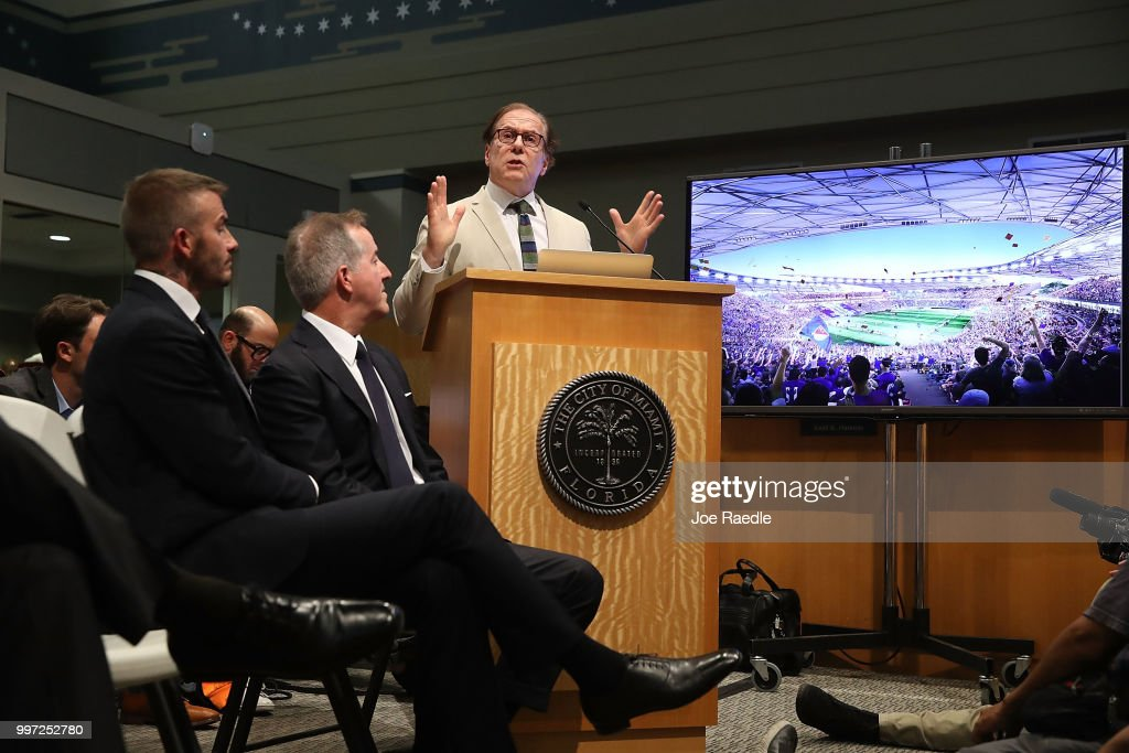 David Beckham and Jorge Mas listen as their architect Bernardo Fort-Brescia speaks during a pubic hearing at the Miami City Hall about building a Major League soccer stadium on a public golf course on July 12, 2018 in Miami, Florida. Mr. Beckham and his partners attended the meeting at city hall in their efforts to build a Major League Soccer stadium in the City of Miami for their professional soccer team.