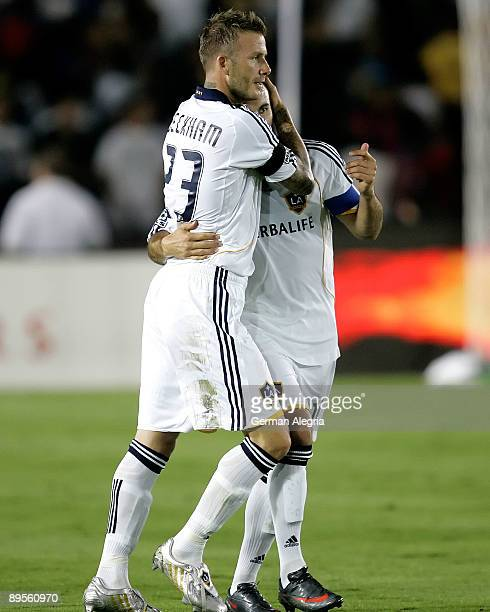 David Beckham and Landon Donovan of the Los Angeles Galaxy celebrate goal scored against FC Barcelona during the first half of the friendly soccer...