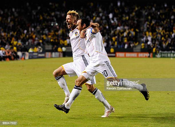 David Beckham and Landon Donovan of the Los Angeles Galaxy celebrate Donovan 's penalty goal against Houston Dynamo during the first half of the...