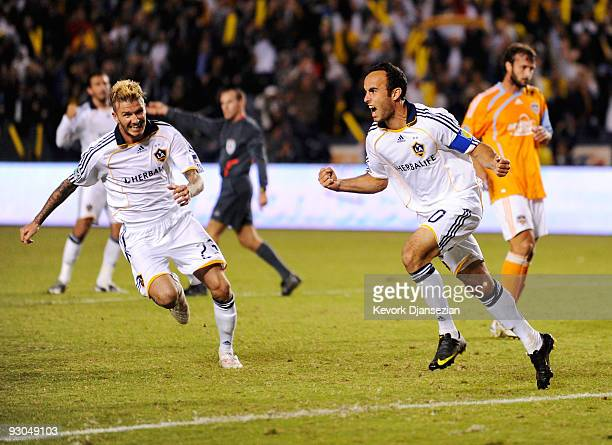 David Beckham and Landon Donovan of the Los Angeles Galaxy celebrate after Donovan's goal on a penalty kick against Houston Dynamo during the MLS...
