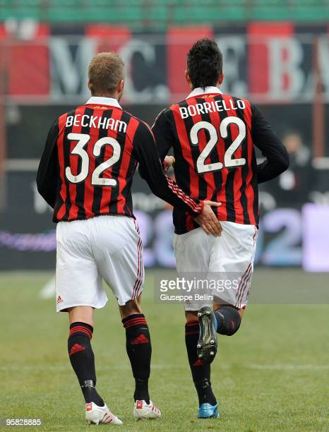 David Beckham and Marco Borriello of Milan celebrate the goal during the Serie A match between Milan and Siena at Stadio Giuseppe Meazza on January...