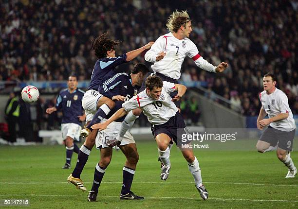 David Beckham and Michael Owen of England challenge the Argentina defence to set up the goal for Wayne Rooney during the International friendly match...