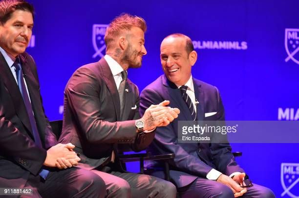 David Beckham and MLS Commissioner Don Garber share a laugh during the press conference awarding the city of Miami with an MLS franchise at the...