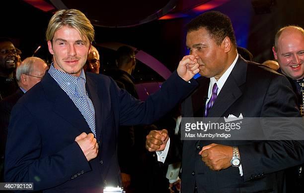 David Beckham and Muhammad Ali winner of the BBC's Sports Personality of the Century Award pretend to box as they attend the BBC Sports Personality...