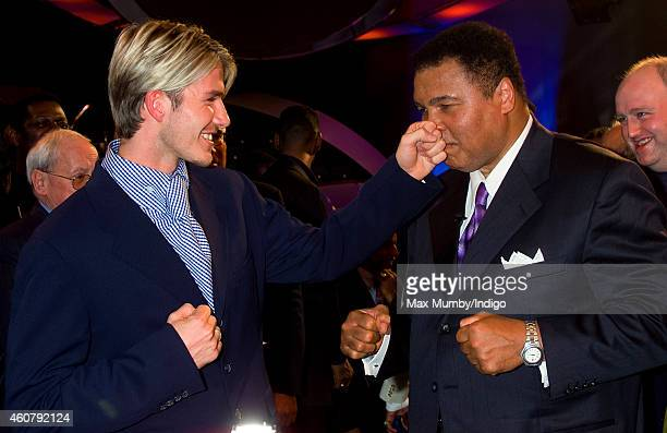 David Beckham and Muhammad Ali winner of the BBC's Sports Personality of the Century Award pretend to box as they attend the BBC Sports Personality...