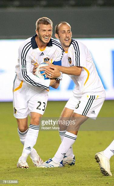David Beckham and Pete Vagenas of the Los Angeles Galaxy battle over who will take a free kick during the celebrity soccer match against Hollywood...