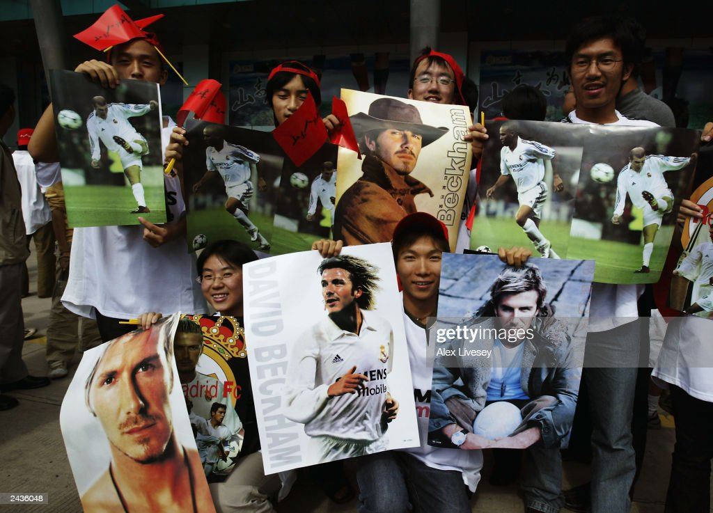 David Beckham and Real Madrid fans outside the Yunnan Tuodong Sports Stadium wait for the team to arrive for a training session on July 29, 2003 at the Yunnan Tuodong Sports Stadium in Kunming, China.