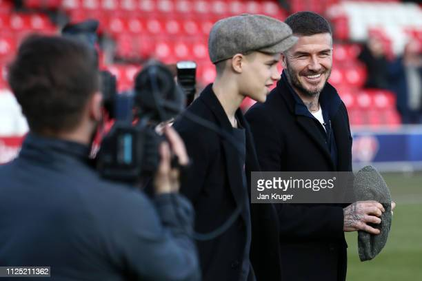 David Beckham and Romeo Beckham inspect the pitch prior to the Vanarama National League match between Salford City and Dover Athletic at Peninsula...