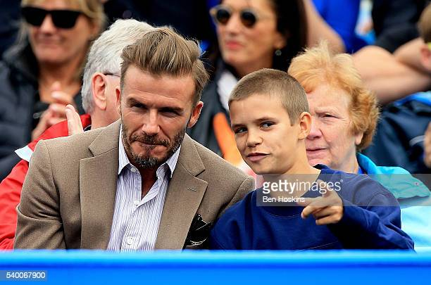 David Beckham and Romeo Beckham watch on during the first round match between Stan Wawrinka of Switzerland and Fernando Verdasco of Spain during day...