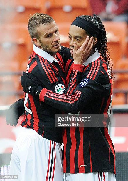 David Beckham and Ronaldinho of Milan celebrate the opening goal a penalty during the Serie A match between Milan and Siena at Stadio Giuseppe Meazza...