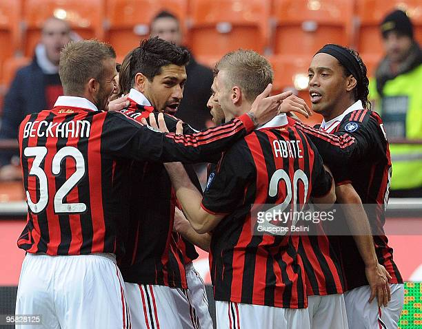 David Beckham and Ronaldinho of Milan celebrate the opening goal during the Serie A match between Milan and Siena at Stadio Giuseppe Meazza on...