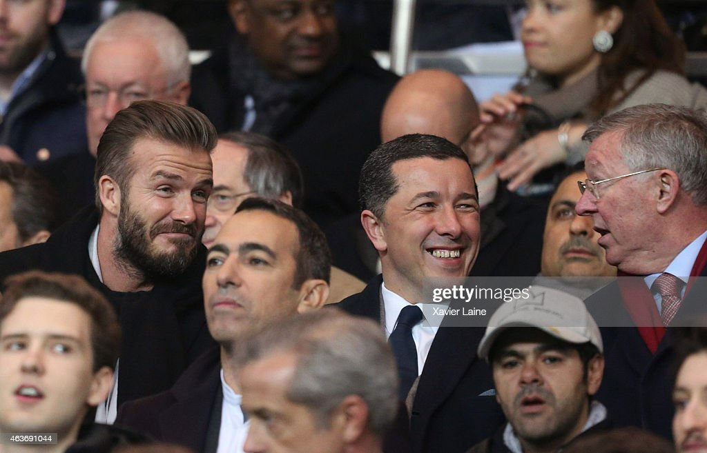David Beckham (L) and Sir Alex Ferguson (R) attend the UEFA Champions League Round of 16 between Paris Saint-Germain and Chelsea at Parc Des Princes on February 17, 2015 in Paris, France.