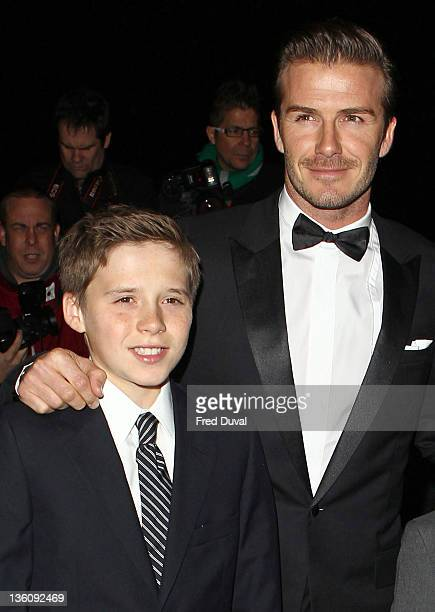 David Beckham and son Brooklyn Beckham attends The Sun Military Awards at Imperial War Museum on December 19, 2011 in London, England.