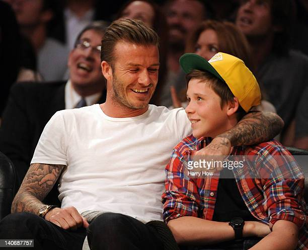 David Beckham and son Brooklyn Beckham take in the game between the Miami Heat and the Los Angeles Lakers at Staples Center on March 4 2012 in Los...