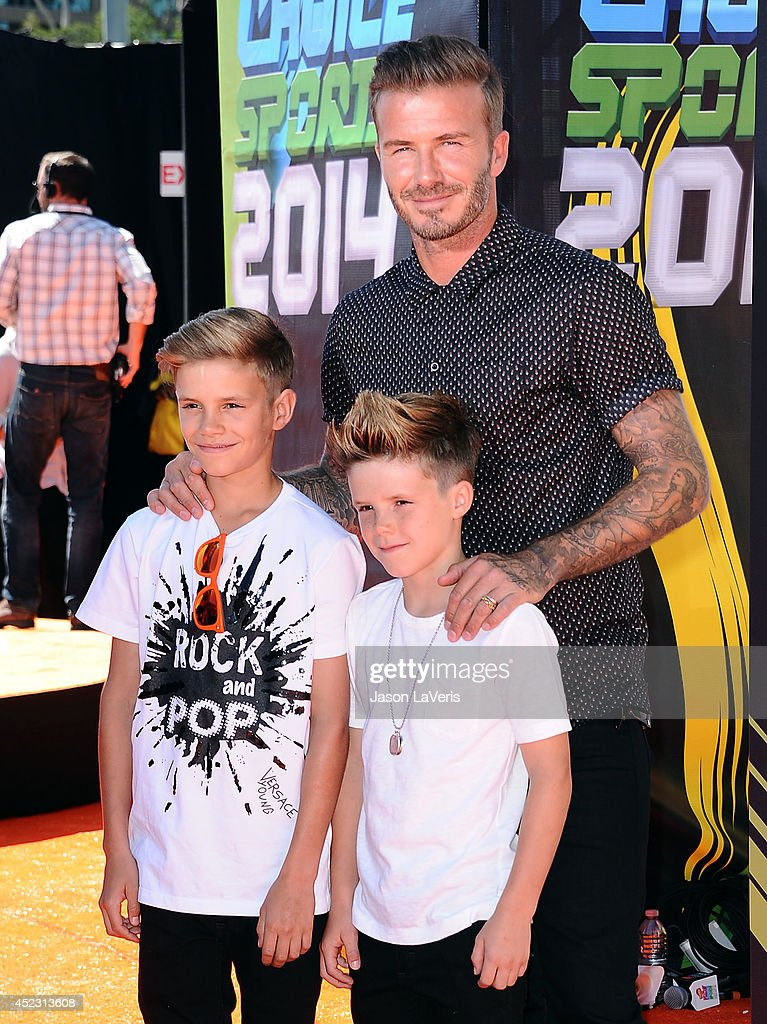 David Beckham and sons Romeo Beckham and Cruz Beckham attend the 2014 Nickelodeon Kids' Choice Sports Awards at Pauley Pavilion on July 17, 2014 in Los Angeles, California.