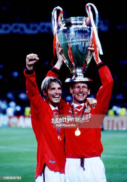 David Beckham and Teddy Sheringham of Manchester United celebrate the victory with the trophy during the UEFA Champions league final match between...