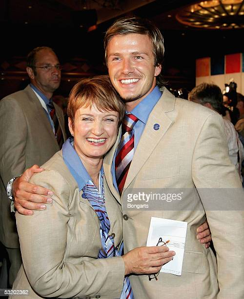 David Beckham and the olympic minister Tessa Jowell celebrate as London are voted to stage the 2012 Olympic Games at the Raffle City Convention...