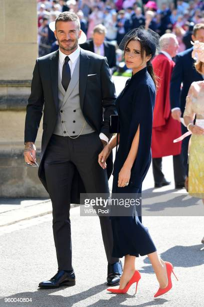 David Beckham and Victoria Beckham arrive at St George's Chapel at Windsor Castle before the wedding of Prince Harry to Meghan Markle on May 19, 2018...
