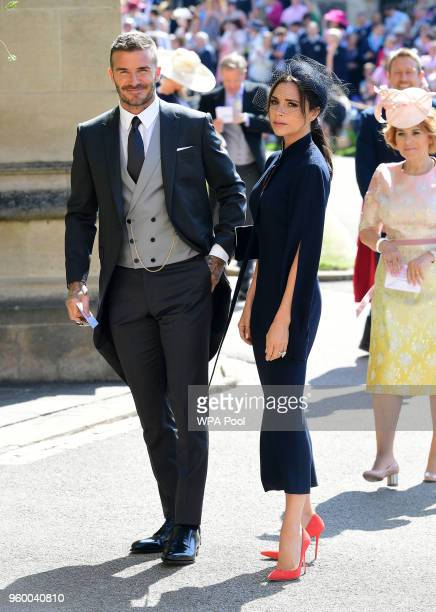 David Beckham and Victoria Beckham arrive at St George's Chapel at Windsor Castle before the wedding of Prince Harry to Meghan Markle on May 19 2018...