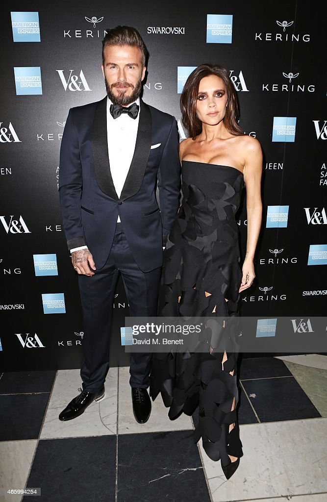 David Beckham (L) and Victoria Beckham arrive at the Alexander McQueen: Savage Beauty Fashion Gala at the V&A, presented by American Express and Kering on March 12, 2015 in London, England.