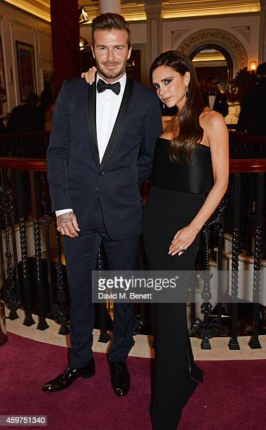 David Beckham and Victoria Beckham attend a champagne reception at the 60th London Evening Standard Theatre Awards at the London Palladium on...