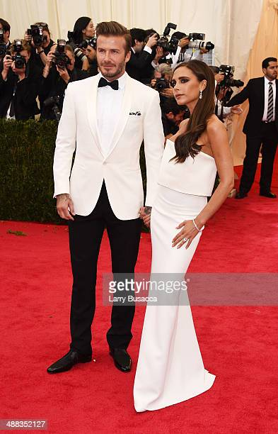 David Beckham and Victoria Beckham attend the Charles James Beyond Fashion Costume Institute Gala at the Metropolitan Museum of Art on May 5 2014 in...