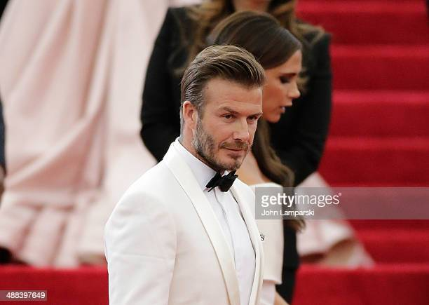 """David Beckham and Victoria Beckham attend the """"Charles James: Beyond Fashion"""" Costume Institute Gala at the Metropolitan Museum of Art on May 5, 2014..."""