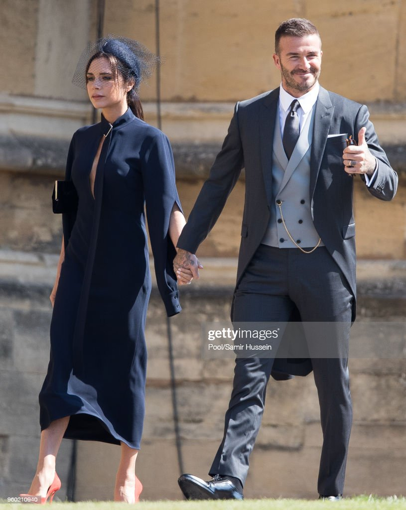 David Beckham and Victoria Beckham attend the wedding of Prince Harry to Ms Meghan Markle at St George's Chapel, Windsor Castle on May 19, 2018 in Windsor, England. Prince Henry Charles Albert David of Wales marries Ms. Meghan Markle in a service at St George's Chapel inside the grounds of Windsor Castle. Among the guests were 2200 members of the public, the royal family and Ms. Markle's Mother Doria Ragland.