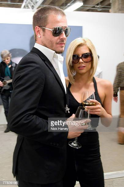 David Beckham and Victoria Beckham lookalikes attend the Phillips De Pury and Company and Taschen Party to launch Confidential by Alison Jackson at...
