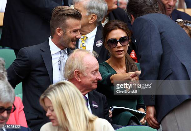 David Beckham and Victoria Beckham sit in the Royal Box during the Gentlemen's Singles final match between Roger Federer of Switzerland and Andy...