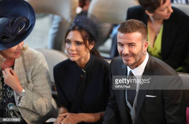 David Beckham and Victoria Beckham take their seats in St George's Chapel at Windsor Castle for the wedding of Prince Harry and Meghan Markle on May...