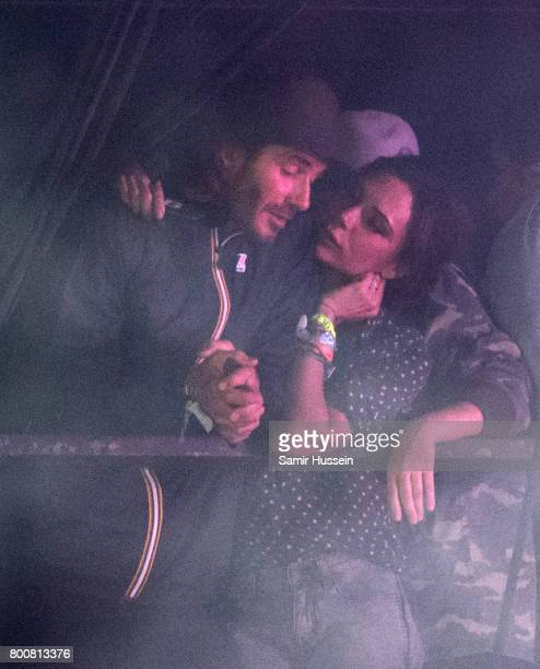David Beckham and Victoria Beckham watch Ed Sheeran perform on day 4 of the Glastonbury Festival 2017 at Worthy Farm Pilton on June 25 2017 in...