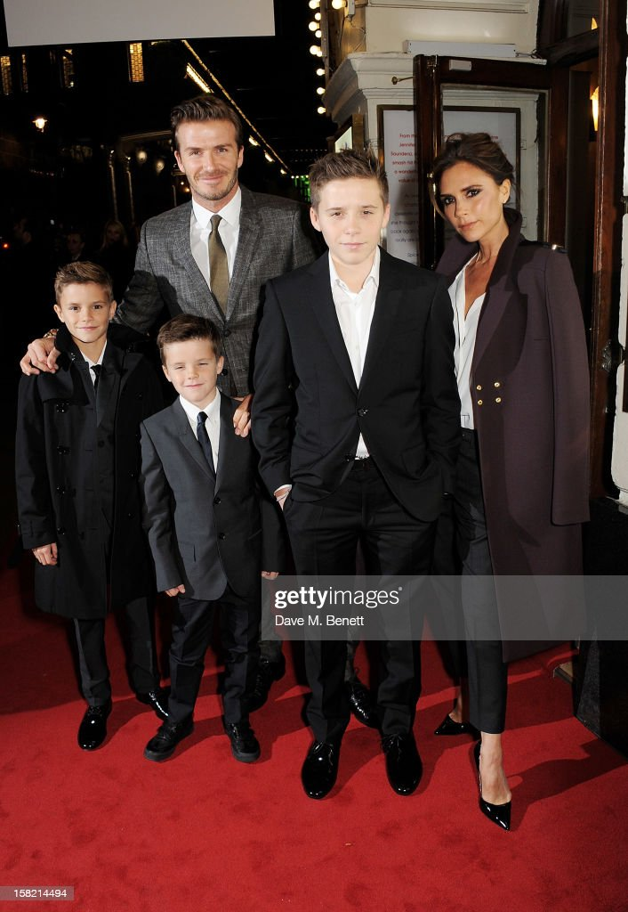 David Beckham (3L) and Victoria Beckham (R) with children Romeo, Cruz and Brooklyn arrive at the Gala Press Night performance of 'Viva Forever' at the Piccadilly Theatre on December 11, 2012 in London, England.
