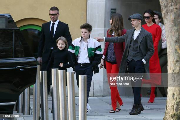 David Beckham and Victoria Beckham with Romeo Cruz and Harper along with Hana Cross depart the Victoria Beckham Show at Tate Britain during LFW...