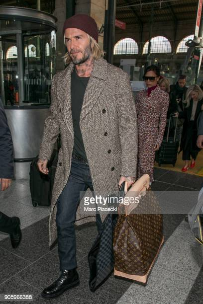David Beckham and wife Victoria Beckham are seen at 'Gare du Nord' station on January 17 2018 in Paris France