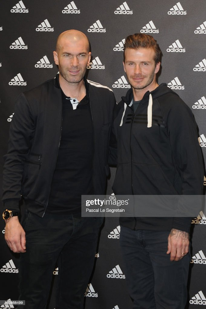 David Beckham and Zinedine Zidane attend an autograph session at adidas Performance Store Champs-Elysees on February 28, 2013 in Paris, France.