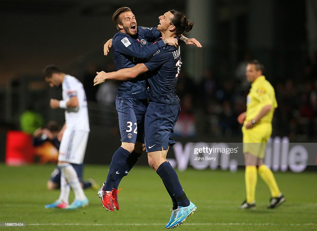 David Beckham and Zlatan Ibrahimovic of PSG celebrate the french Ligue 1 title of PSG after the Ligue 1 match between Olympique Lyonnais, OL, and Paris Saint-Germain FC, PSG, at the Stade Gerland on May 12, 2013 in Lyon, France.