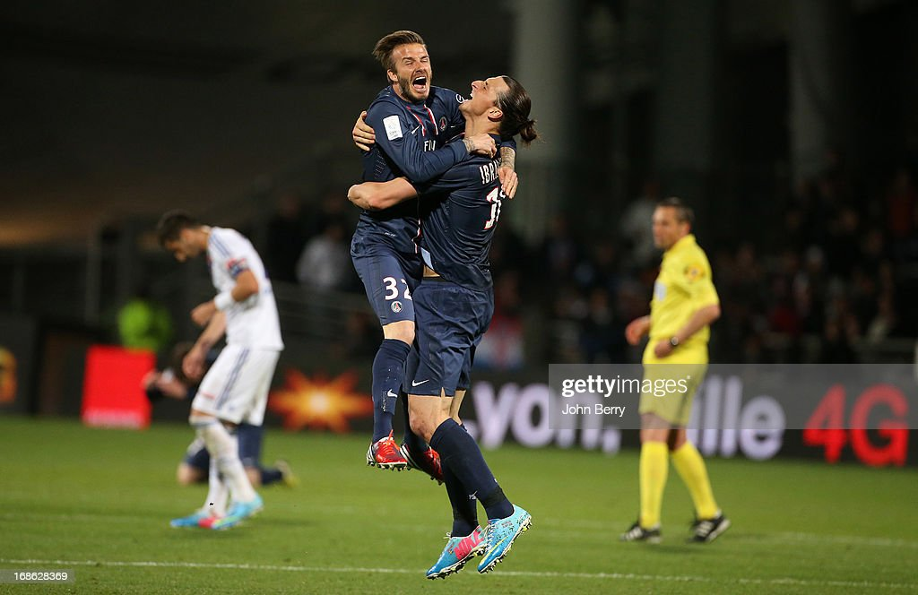 David Beckham and Zlatan Ibrahimovic of PSG celebrate the french Ligue 1 championships title of PSG after the Ligue 1 match between Olympique Lyonnais, OL, and Paris Saint-Germain FC, PSG, at the Stade Gerland on May 12, 2013 in Lyon, France.