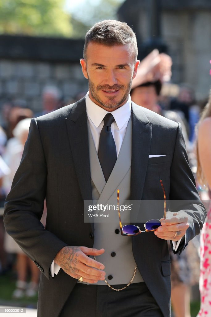 David Beckham arrives at St George's Chapel at Windsor Castle before the wedding of Prince Harry to Meghan Markle on May 19, 2018 in Windsor, England.