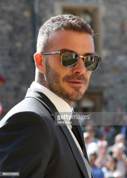 David Beckham arrives at St George's Chapel at Windsor Castle before the wedding of Prince Harry to Meghan Markle on May 19 2018 in Windsor England