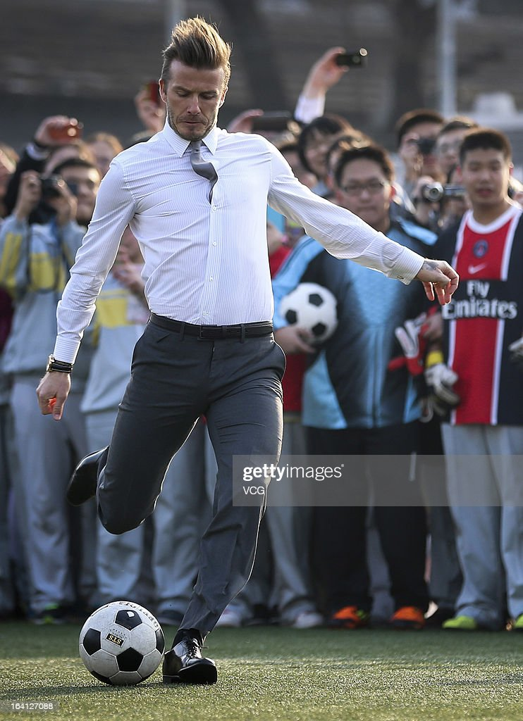 David Beckham attends a grassroots and junior football promotional with students at No.2 High school on March 20, 2013 in Beijing, China.