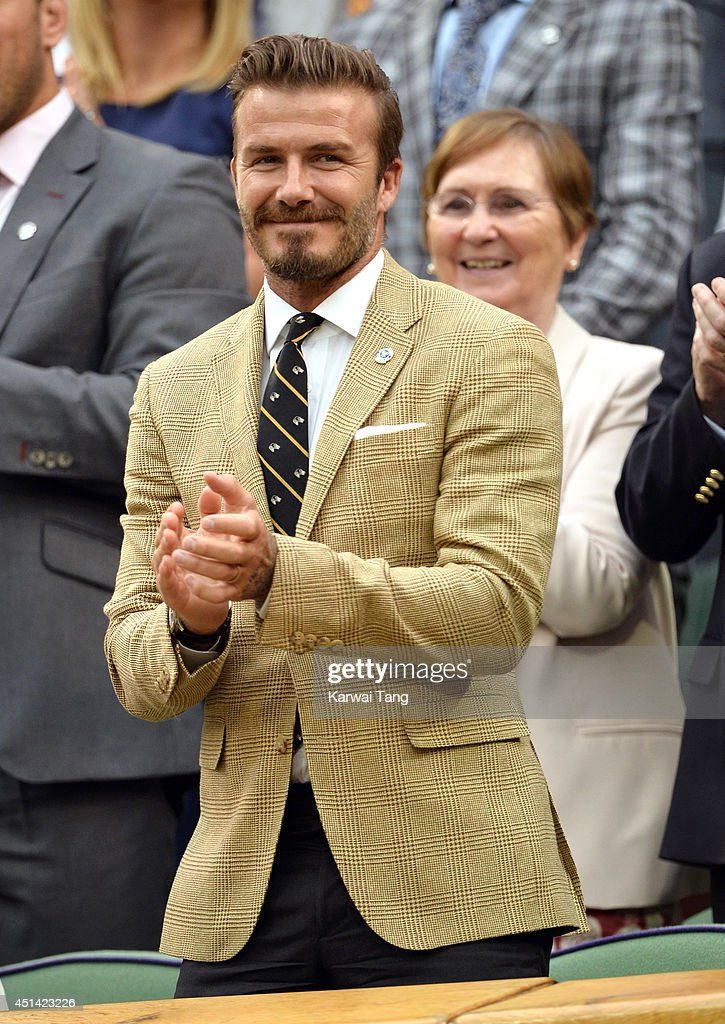 David Beckham attends the Mikhail Kuskushkin v Rafael Nadal match on centre court during day six of the Wimbledon Championships at Wimbledon on June 28, 2014 in London, England.