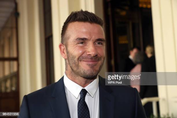 David Beckham attends the Queen's Young Leaders Award Ceremony as Queen Elizabeth II accompanied by Prince Harry Duke of Sussex and Meghan Duchess of...