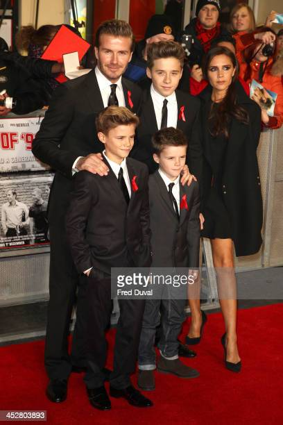 David Beckham Brooklyn Beckham Victoria Beckham Romeo Beckham and Cruz Beckham attend the premiere of 'The Class Of 92' at Odeon West End on December...