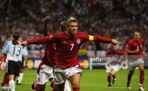 David Beckham Captain of England celebrates scoring during the Group F against Argentina at the World Cup Group Stage played at the Sapporo Dome,...